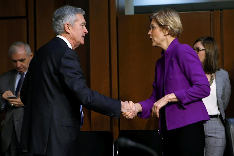 Jerome Powell greets Senator Elizabeth Warren (D-MA) before testifying to the Senate Banking, Housing and Urban Affairs Committee on his nomination to become chairman of the U.S. Federal Reserve in Washington, U.S., November 28, 2017. REUTERS/Joshua Roberts