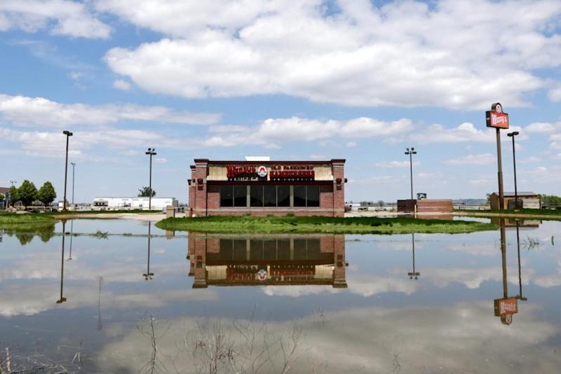 A Wendy's hamburger restaurant in Percival, Iowa, is reflected in floodwaters from the Missouri River.