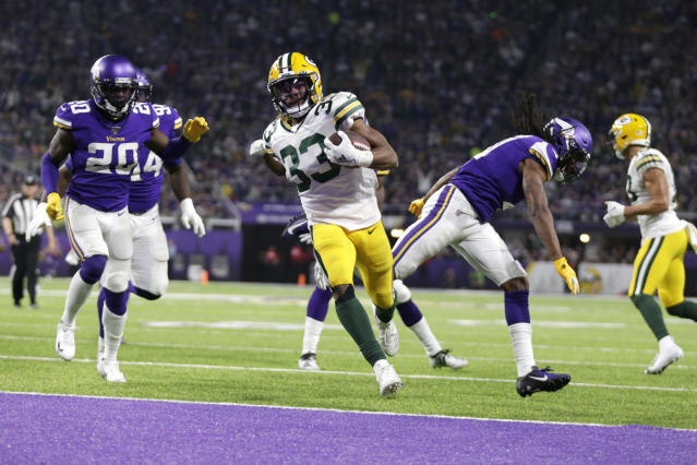 Green Bay Packers running back Aaron Jones (33) scores on a 12-yard touchdown run during the second half of the team's NFL football game against the Minnesota Vikings, Monday, Dec. 23, 2019, in Minneapolis. (AP Photo/Andy Clayton-King)