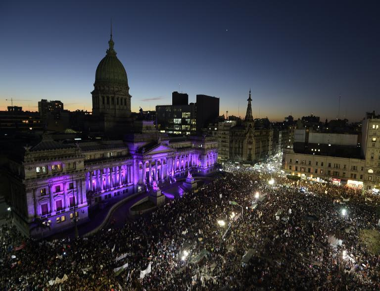 "People gather in front of the Congress building to take part in a demonstration ""Ni una menos"" (Not One Less) in Buenos Aires, on June 3, 2015"
