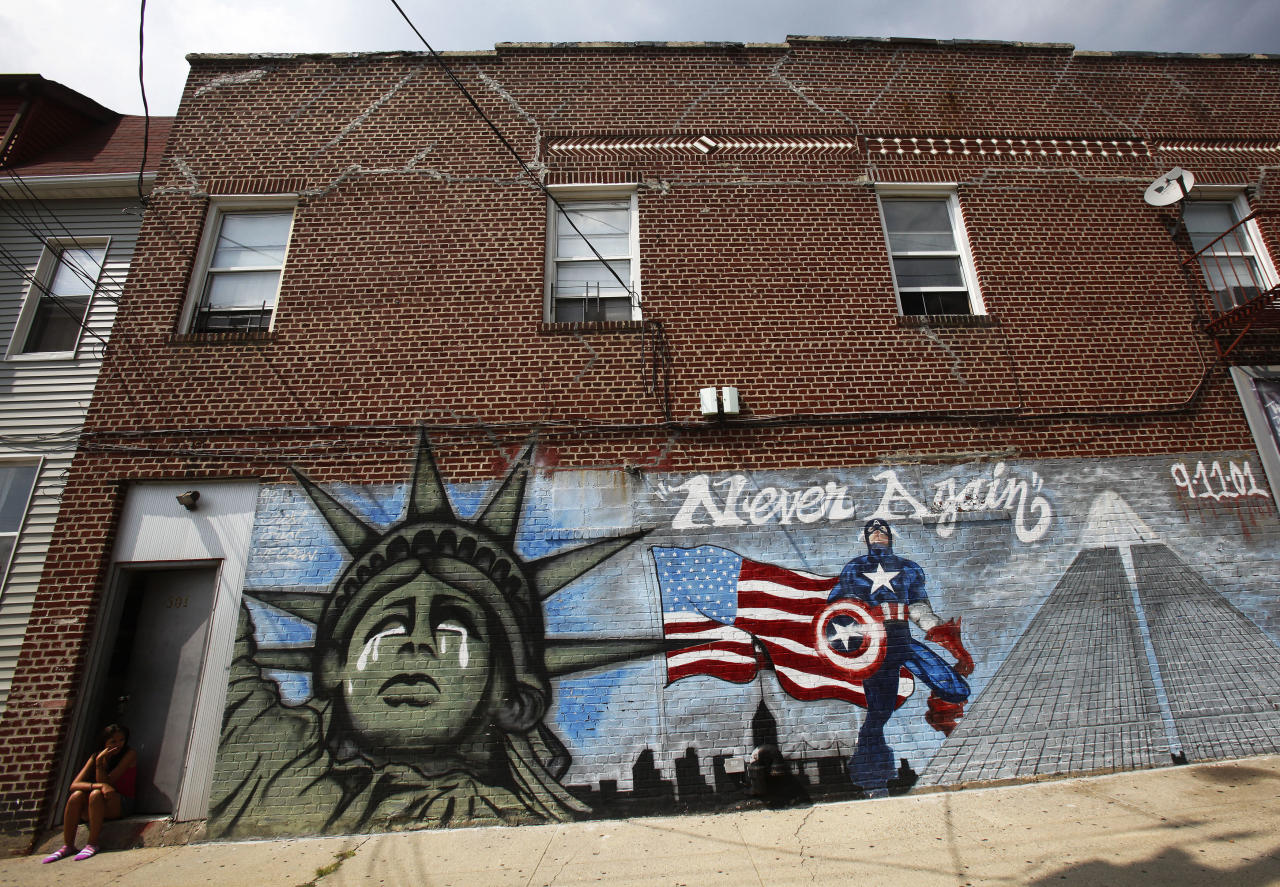 A mural, honoring victims of the September 11, 2001 attacks on the World Trade Center, is seen in the Bronx borough of New York August 1, 2011. (REUTERS/Shannon Stapleton)