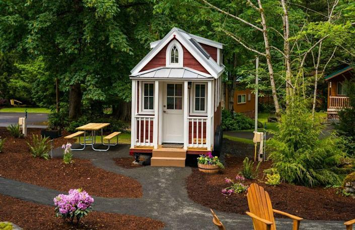 """<p>The Elm features a fully functional tiny porch and can sleep up to three people.<br></p><p><a class=""""link rapid-noclick-resp"""" href=""""https://go.redirectingat.com?id=74968X1596630&url=https%3A%2F%2Fwww.tumbleweedhouses.com%2Ftumbleweed-models%2Felm%2F%23%21&sref=https%3A%2F%2Fwww.oprahdaily.com%2Flife%2Fg35047961%2Ftiny-house%2F"""" rel=""""nofollow noopener"""" target=""""_blank"""" data-ylk=""""slk:SHOP NOW"""">SHOP NOW</a> <a class=""""link rapid-noclick-resp"""" href=""""https://www.countryliving.com/life/travel/g3595/tour-tiny-house-village/"""" rel=""""nofollow noopener"""" target=""""_blank"""" data-ylk=""""slk:SEE INSIDE"""">SEE INSIDE</a></p>"""