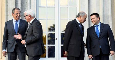 REFILE - Foreign ministers (L-R) Sergei Lavrov of Russia, Frank-Walter Steinmeier of Germany, Laurent Fabius of France and Pavlo Klimkin of Ukraine leave for their meeting after a picture opportunity at the German foreign ministry's Villa Borsig at lake Tegel in Berlin, Germany September 12, 2015. REUTERS/Tobias Schwarz/Pool