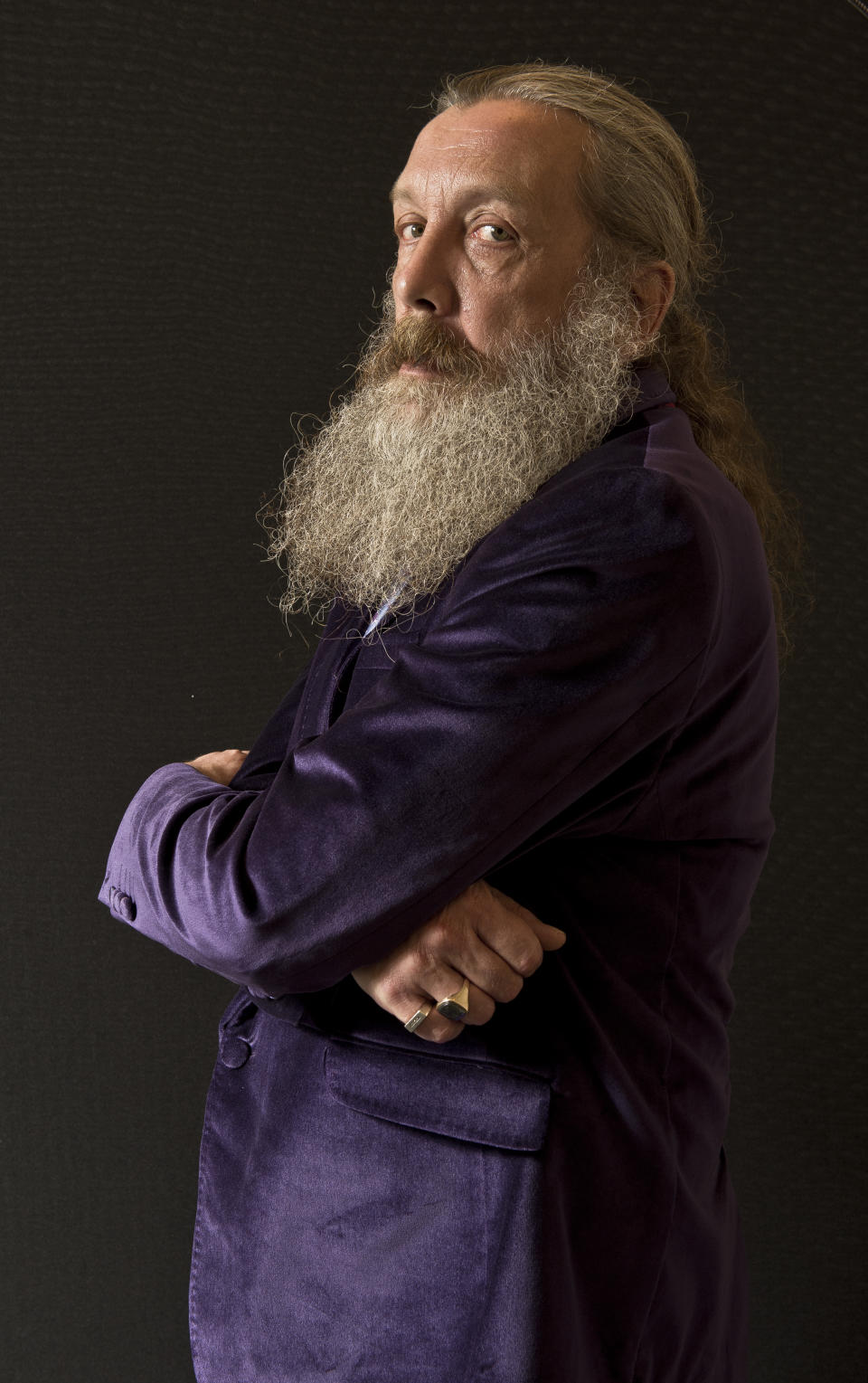 LONDON, UNITED KINGDOM - SEPTEMBER 6: Portrait of English comic book writer Alan Moore, taken on September 6, 2013. Moore is often considered the finest writer in the comics medium, and is best known for his graphic novels Watchmen and V For Vendetta. (Photo by Kevin Nixon/SFX Magazine via Getty Images)