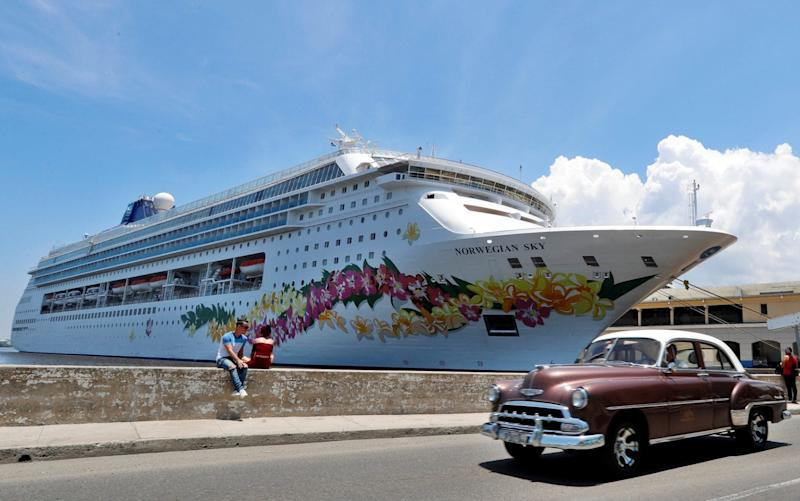 A classic car passes in front of the cruise terminal in Havana on June 4 - REX
