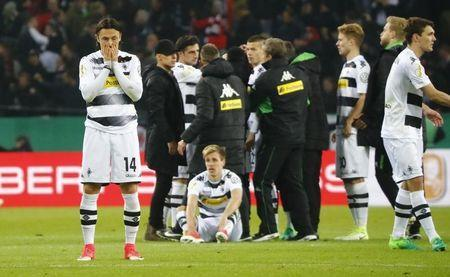 Football Soccer - Borussia Monchengladbach v Eintracht Frankfurt - DFB Pokal Semi Final - Borussia-Park, Monchengladbach, Germany - 25/4/17 Borussia Monchengladbach's Nico Schulz and teammates look dejected after losing the match with a penalty shootout Reuters / Wolfgang Rattay Livepic