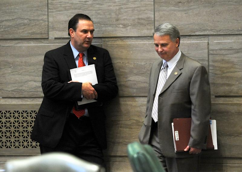 In this March 30, 2011 photo, Sen. Mike Kehoe, R-Jefferson City, left, and Senate President Pro Tem  Rob Mayer, R-Dexter, confer briefly at the State Capitol in Jefferson City, Mo. Right-to-work bills have been considered this year in 14 states, including Missouri, but many are faltering. Mayer has said he plans to bring the issue up again in the Senate before the session ends. Keheo, who owns a car dealership, has said he supports efforts to improve the state's business climate but that he doesn't think right-to-work legislation is a magic wand. (AP Photo/Kelley McCall)
