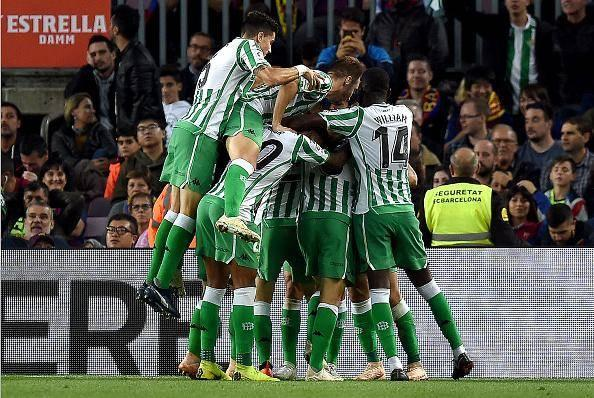 Real Betis players celebrate after scoring their third goal against Barcelona (Getty)