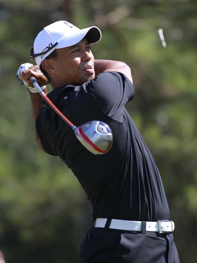 Tiger Woods hits from the ninth tee during the second round of the Players Championship golf tournament at TPC Sawgrass, Friday, May 11, 2012, in Ponte Vedra Beach, Fla. (AP Photo/John Raoux)