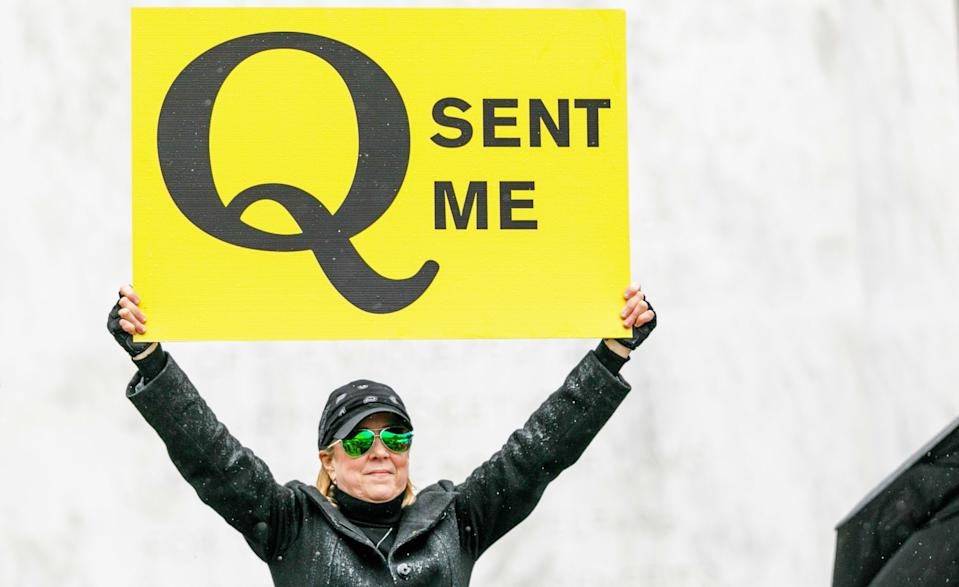 A Q-Anon supporter during a protest at the State Capitol in Salem, Oregon, United States on May 2, 2020. (Photo by John Rudoff/Anadolu Agency via Getty Images)