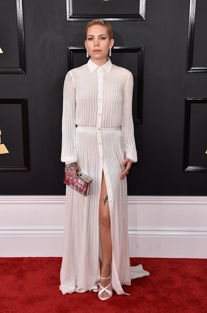 Skylar Grey attends The 59th GRAMMY Awards at STAPLES Centerwith her #RefreshTheTalk clutch on the Grammy Awards red carpet.
