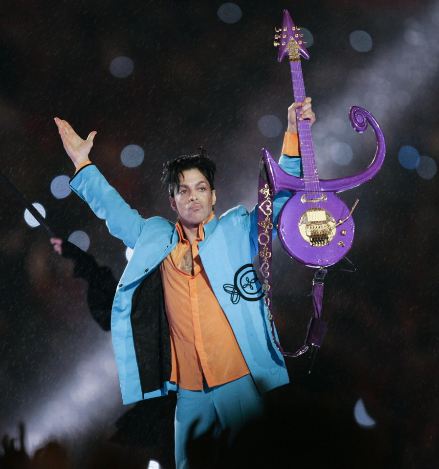 FILE - In this Feb. 4, 2007 file photo, Prince performs during halftime of the Super Bowl XLI football game in Miami. A legal wrinkle in Prince's estate case shows you might not have to be a blood relative to inherit some of the late rock superstar's sizable fortune. No will has surfaced since Prince accidentally overdosed on painkillers in April, so his sister, Tyka Nelson, and five half-siblings are likely to be declared rightful heirs within the next few months. (AP Photo/Chris O'Meara, File)