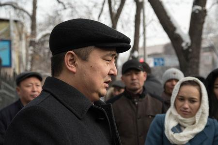 Kazakh rights activist Serikzhan Bilash speaks to reporters outside a courthouse in Almaty, Kazakhstan, February 13, 2019. Picture taken February 13, 2019. REUTERS/Mariya Gordeyeva