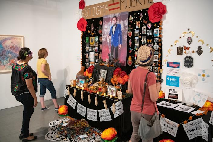 """A Day of the Dead altar, """"Altar for Carlos Zaragoza,"""" at Self Help Graphics' community arts workshop last year. <span class=""""copyright"""">(Michael Owen Baker / For The Times)</span>"""