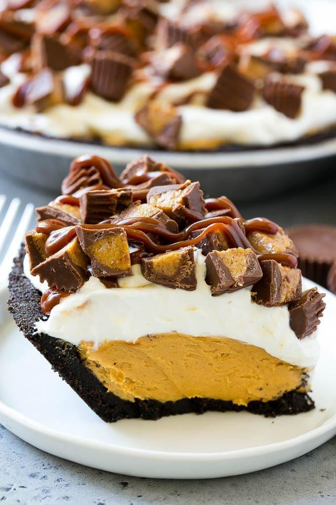 "<p>Chocolate + peanut butter = a match made in dessert heaven. As a sweet bonus, this pie is finished with <a href=""https://go.redirectingat.com?id=74968X1596630&url=https%3A%2F%2Fwww.walmart.com%2Fip%2FReese-s-Peanut-Butter-Cup-Miniatures-Party-Bag-35-6-oz%2F610414849&sref=https%3A%2F%2Fwww.countryliving.com%2Ffood-drinks%2Fg957%2Fchocolate-pie-recipes%2F"" rel=""nofollow noopener"" target=""_blank"" data-ylk=""slk:Reese's Peanut Butter Cups"" class=""link rapid-noclick-resp"">Reese's Peanut Butter Cups</a>.</p><p><strong>Get the recipe at <a href=""https://www.dinneratthezoo.com/chocolate-peanut-butter-pie/"" rel=""nofollow noopener"" target=""_blank"" data-ylk=""slk:Dinner at the Zoo"" class=""link rapid-noclick-resp"">Dinner at the Zoo</a>.</strong></p><p><strong><a class=""link rapid-noclick-resp"" href=""https://go.redirectingat.com?id=74968X1596630&url=https%3A%2F%2Fwww.walmart.com%2Fip%2FCuisinart-Elemental-8-Cup-Food-Processor-Gunmetal-FP-8GM%2F44997813&sref=https%3A%2F%2Fwww.countryliving.com%2Ffood-drinks%2Fg957%2Fchocolate-pie-recipes%2F"" rel=""nofollow noopener"" target=""_blank"" data-ylk=""slk:SHOP FOOD PROCESSORS"">SHOP FOOD PROCESSORS</a><br></strong></p>"