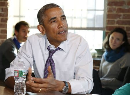U.S. President Barack Obama speaks about his legislation proposal to offer paid sick leave for Americans while at Charmington's Cafe in Baltimore