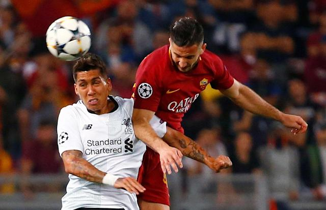 Soccer Football - Champions League Semi Final Second Leg - AS Roma v Liverpool - Stadio Olimpico, Rome, Italy - May 2, 2018 Roma's Konstantinos Manolas in action with Liverpool's Roberto Firmino REUTERS/Tony Gentile