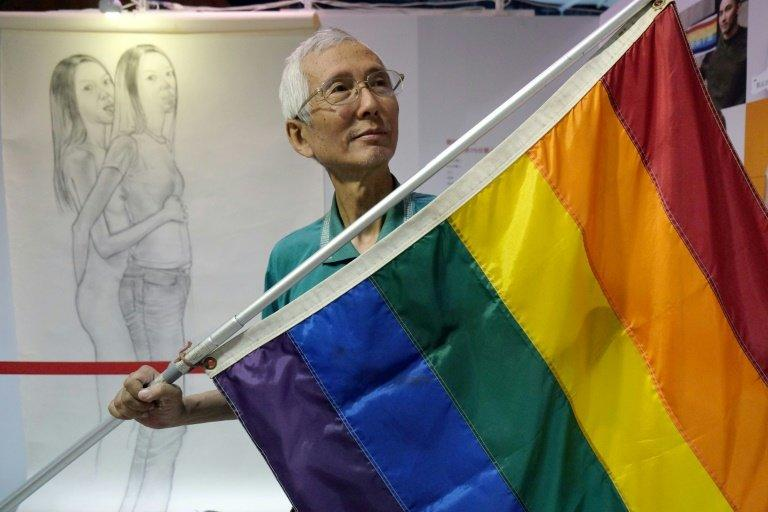 Taiwanese gay rights campaigner Chi Chia-wei, 59, poses for a photograph with a flag. Taiwan could become the first place in Asia to legalise gay marriage on Wednesday when a court makes a landmark ruling on whether to allow same-sex unions