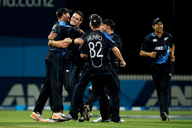 HAMILTON, NEW ZEALAND - FEBRUARY 12:  Mitchell McClenaghan of New Zealand celebrates with teammates after dismissing Luke Wright of England during the international Twenty20 match between New Zealand and England at Seddon Park on February 12, 2013 in Hamilton, New Zealand.  (Photo by Gareth Copley/Getty Images)