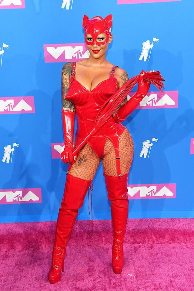 "<p>Rose totally fit in on the red carpet in <a href=""https://www.yahoo.com/lifestyle/internet-doesnt-understand-amber-rose-wore-latex-catsuit-vmas-022125960.html"" data-ylk=""slk:a bright red latex suit;outcm:mb_qualified_link;_E:mb_qualified_link"" class=""link rapid-noclick-resp yahoo-link"">a bright red latex suit</a> — and that's what's so fun about the VMAs. (Photo: Nicholas Hunt/Getty Images for MTV) </p>"