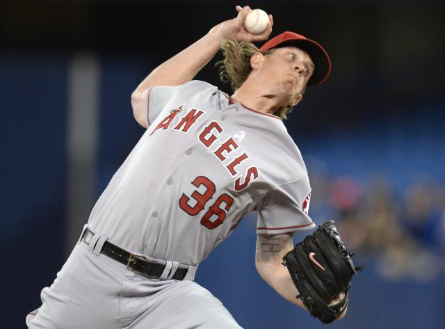 Los Angeles Angels starting pitcher Jered Weaver works against the Toronto Blue Jays during first-inning baseball game action in Toronto, Sunday, May 11, 2014. (AP Photo/The Canadian Press, Frank Gunn)