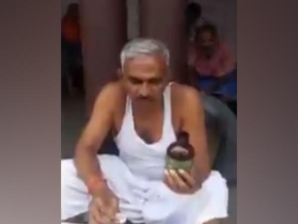 Surendra Singh, BJP MLA from Bairia in Ballia district, has put up a video of himself drinking cow urine. (Photo/ANI)