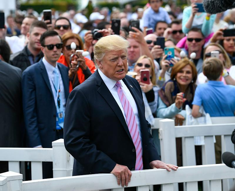 April 22, 2019; Washington, DC, USA; President Donald J. Trump makes remarks to the media as he walks back to the oval office following opening remarks and watching groups of children participate in the 2019 White House Easter Egg Roll. Mandatory Credit: Jack Gruber-USA TODAY /Sipa USA