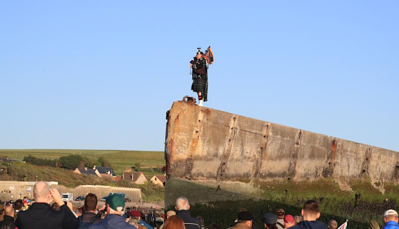 The lone piper played on the Mulberry harbour at Arromanches as part of activities to mark the exact moment the first British soldier landed on Gold beach 75 years ago (Picture: PA)