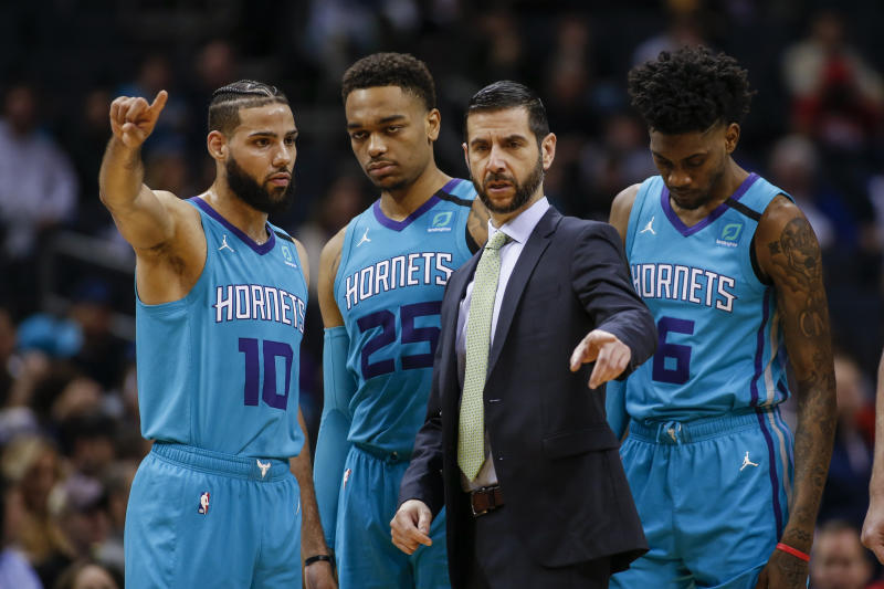 Charlotte Hornets head coach James Borrego coaches Charlotte Hornets forwards Caleb Martin (10), P.J. Washington (25) and Jalen McDaniels (6) during the first half of an NBA basketball game against the Denver Nuggets in Charlotte, N.C., Thursday, March 5, 2020. Denver won 114-112. (AP Photo/Nell Redmond)