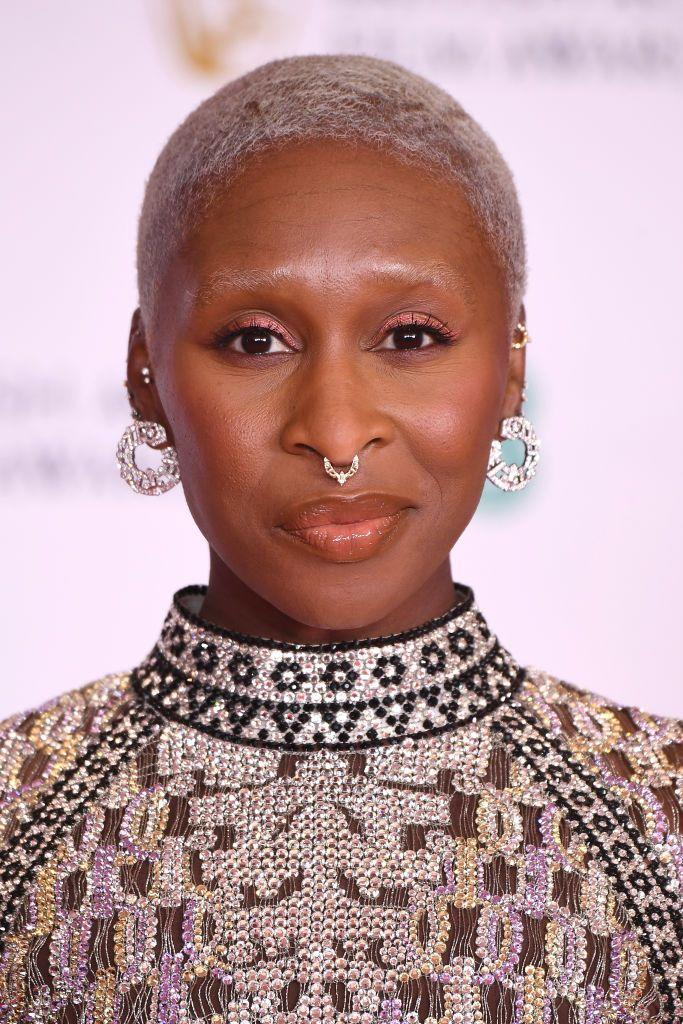 <p>Cynthia Erivo picked out the sparkling shades of her Louis Vuitton dress with an iridescent, bronze-toned eyeshadow and light-reflecting glossy lip. </p>