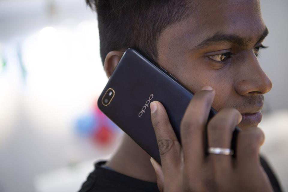 A man uses an Oppo smartphone at a shopping centre in Chennai, India, on October 8. India and Southeast Asia are Oppo's two biggest markets outside China. Photo: Xinhua