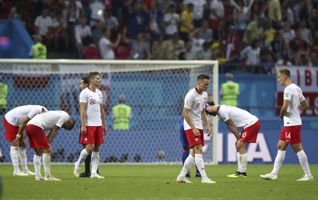 Poland's players react after the group H match between Poland and Colombia at the 2018 soccer World Cup at the Kazan Arena in Kazan, Russia, Sunday, June 24, 2018. Colombia won 3-0. (AP Photo/Thanassis Stavrakis)