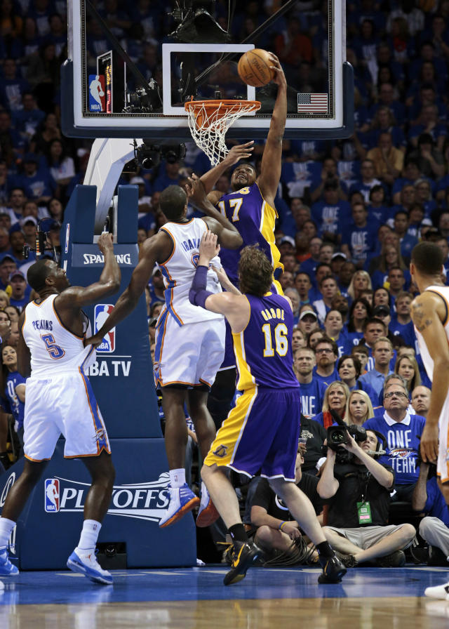 OKLAHOMA CITY, OK - MAY 14: Andrew Bynum #17 of the Los Angeles Lakers slam dunks in front of Serge Ibaka #9 of the Oklahoma City Thunder in Game One of the Western Conference Semifinals in the 2012 NBA Playoffs on May 14, 2012 at the Chesapeake Energy Arena in Oklahoma City, Oklahoma. NOTE TO USER: User expressly acknowledges and agrees that, by downloading and or using the photograph, User is consenting to the terms and conditions of the Getty Images License Agreement. (Photo by Brett Deering/Getty Images)