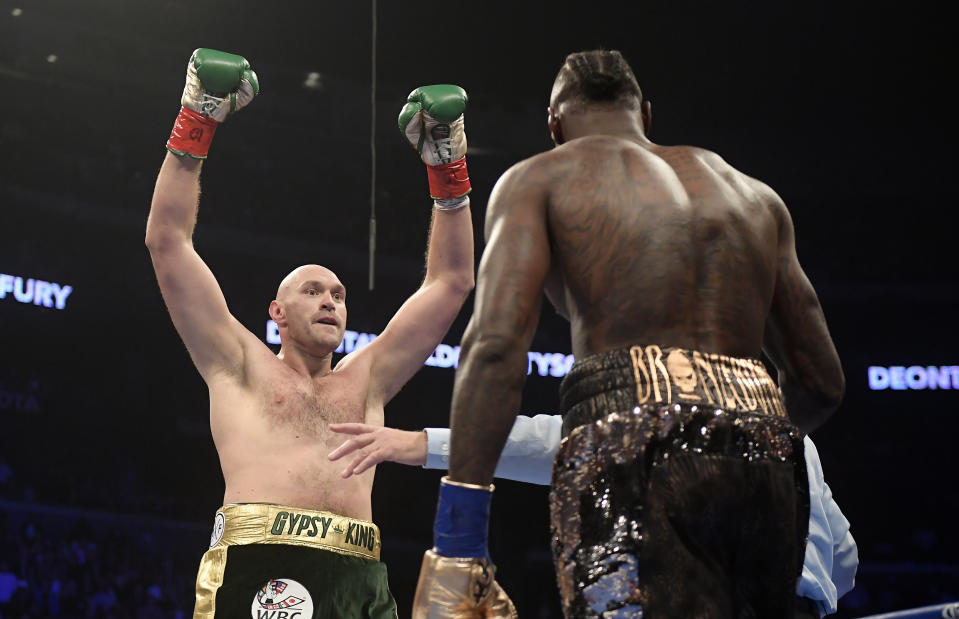 Tyson Fury, left, of England, taunts Deontay Wilder during the first round of a WBC heavyweight championship boxing match, Saturday, Dec. 1, 2018, in Los Angeles. (AP Photo/Mark J. Terrill)