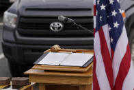 The House Speaker's gavel rests on a podium prior to an outdoor meeting of the New Hampshire House of Representatives in a parking lot, due to the COVID-19 virus outbreak, at the University of New Hampshire Wednesday, Jan. 6, 2021, in Durham, N.H. The legislative group gathered to begin business for the new year, which included again electing a House Speaker, after the death in December 2020 of newly-elected House Speaker Dick Hinch, who died of COVID-19. (AP Photo/Charles Krupa)