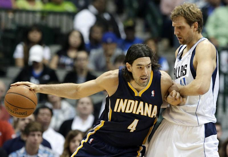 Indiana Pacers' Luis Scola (4), of Argentina, pushes off Dallas Mavericks' Dirk Nowitzki, of Germany, before attempting a shot in the first half of a preseason NBA basketball game, Friday, Oct. 25, 2013, in Dallas. (AP Photo/Tony Gutierrez)