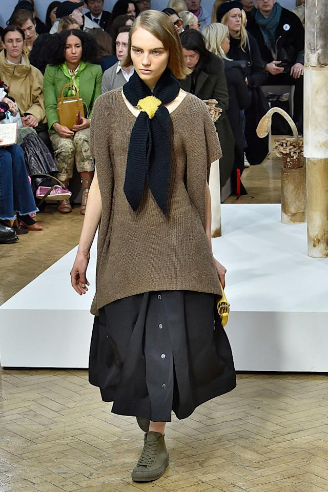 <p>The super-chic neck tie is back and bigger than ever this season. Over at JW Anderson, models stepped out in woollen numbers tied neatly above supersized knits. <em>[Photo: Getty]</em> </p>