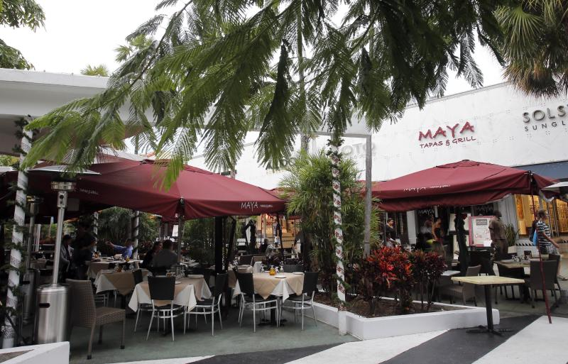 "The Maya and Tapas Grill restaurant in Miami Beach, Fla., Thursday, Dec. 13, 2012. ""Eat in Miami, pay in pesos!"" the ad for the Maya Tapas & Grill restaurant proclaims. At the Maya restaurant along Miami Beach's famed Lincoln Road, clients can pay in Argentine pesos at the official exchange rate. (AP Photo/Alan Diaz)"