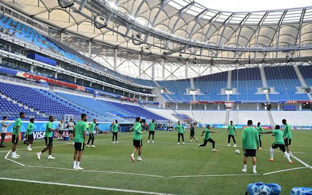 Saudi Arabia vs Egypt, World Cup 2018 Group A clash, kicks off at 3pm on ITV 4 Get live updates from Uruguay vs Russia in our liveblog World Cup 2018 groups: current tables, standings and permutations for round of 16 You are the VAR: Think you can do better than the World Cup referees? Test yourself here Get Telegraph Football WhatsApp for in-match analysis and talking points throughout the World Cup Betting guide: predictions and tips for Saudi Arabia v Egypt WorldCup - newsletter promo - end of article 2:10PM Starting lineups Saudi Arabia Almosailem; Osama, Alburayk, Salman, Hatan, Yasser, Otayf, Hussain, Salem, Fahad, Motaz Egypt Elhadary; Ali Gabr, Hegazy, Fathi, Tarek Hamed, Marwan, Salah, Abdelshafy, Elneny, Abdalla, Treziguet, 2:07PM Fans getting in early Credit: AFP Even though it's a dead rubber, Egypt fans are enjoying themselves. Quite a few have already made their way inside the stadium and the players have been out to inspect the pitch. I can confirm that there is grass and sunshine - the two most crucial factors in any game of football. Also a football is needed. 1:40PM Where is the game today? Well my friends, that would be the Volgograd Arena! World Cup 2018 stadium: Volgograd Arena 1:29PM A battle for... pride? We're officially over the halfway stage in the World Cup and already we have a game that means absolutely nothing to anybody, other than the supporters of both Saudi Arabia and Egypt. Things haven't gone as planned for Mo Salah and co, while Saudi Arabia put on about as inept an international football performance - certainly that I've - ever seen in their opening game and offered nothing against Uruguay. It could have been so different! All that hope. The hope! The hope destroyed when Mo Salah fell to the floor under the weight of Sergio Ramos - one of those unfortunate incidents that helps to write history. Credit: PA So what do we have today? Well, in the green corner we have a team who try to play like peak Pep Guardiola Barcelona but who don't seem to be able to pass the ball across their backline without conceding a goal, and in the red (or white) we have a team reliant on its one true (broken) star. Salah clearly wasn't at full fitness in Egypt's crushing defeat to Russia, wisely opting not to go in for risky 50/50s and looking a little short of confidence too, making passes when it's definitely in everyone's best interest that he tries shooting from 30 yards. Neither team can qualify for the knock-out stages because both have zero points and so today is all about clawing a bit of pride, having a bit of fun and just enjoying the final part of their involvement in this brilliant festival of fitba. World Cup record: Egypt Today might be one of those games where players have a go from 40 yards because why the hell not, forwards might attempt to dribble the length of the pitch just to see if they can, and nobody should really be too fired up. The points should go to Egypt, who have a far better organised defence and more creative forwards but if Saudi Arabia can get some of those passing moves they used in the early stages of the Russia game on show, might pull of a surprise win. Team news will be in soon and we'll bring you that and live coverage and analysis of the rest of the game.