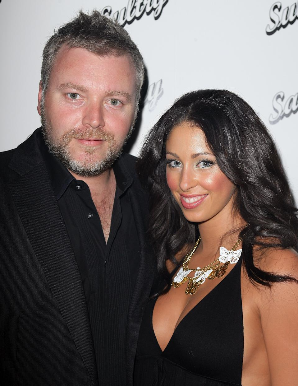 Kyle Sandilands and Tamara Jaber pose on the red carpet.