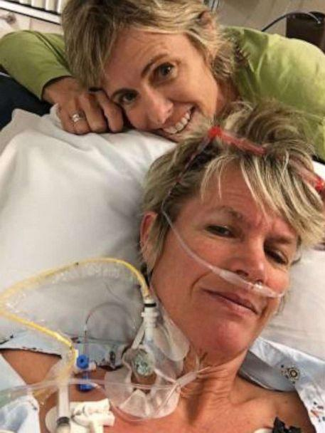 PHOTO: Genie Kilpatrick recovering in the hospital with wife, Sheri Norris, by her side. (Sheri Norris)