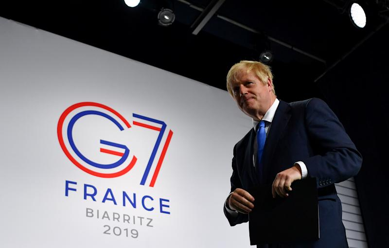 Britain's Prime Minister Boris Johnson leaves a news conference at the end of the G7 summit in Biarritz, France, August 26, 2019. REUTERS/Dylan Martinez