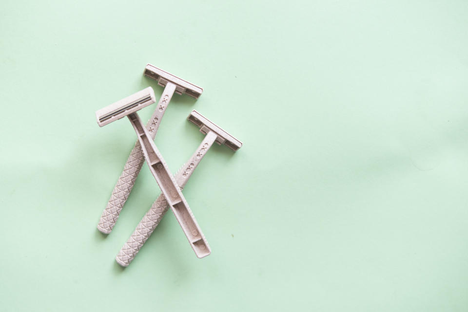 Directly Above Shot Of Razors On Green Background