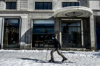 A man skis at Espana square in downtown Madrid, Spain, Sunday, Jan. 10, 2021. A large part of central Spain including the capital of Madrid are slowly clearing snow after the country's worst snowstorm in recent memory. (AP Photo/Manu Fernandez)