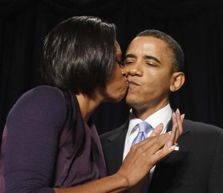 First lady Michelle Obama (L) kisses Barack following his remarks at the National Prayer Breakfast at a Washington hotel February 4, 2010.