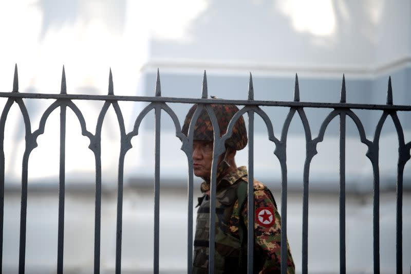 A Myanmar soldier looks on as he stands inside city hall after soldiers occupied the building, in Yangon