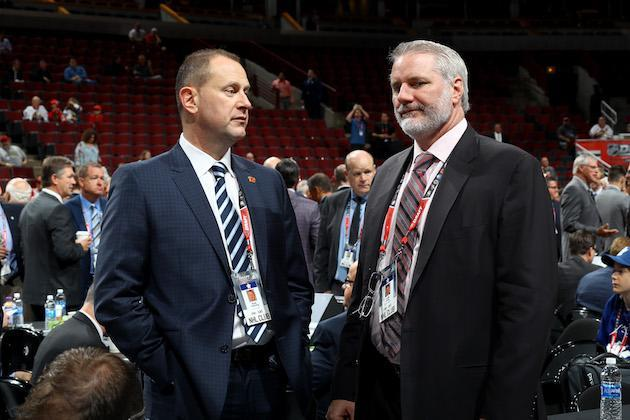 CHICAGO, IL – JUNE 24: Calgary Flames general manager Brad Treliving and New York Islanders general manager Garth Snow meet during 2017 NHL Draft at the United Center on June 24, 2017 in Chicago, Illinois. (Photo by Bruce Bennett/Getty Images)