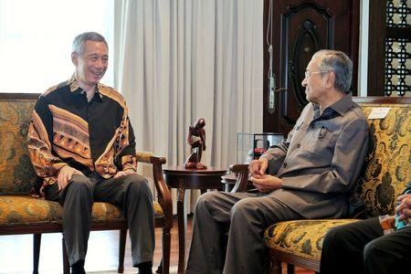 Malaysia's Prime Minister Mahathir Mohamad meets with Singapore's Prime Minister Lee Hsien Loong at the Perdana Leadership Foundation in Putrajaya, Malaysia on May 19, 2018 in this handout photo. Singapore's Ministry of Communication and Information/Handout via REUTERS