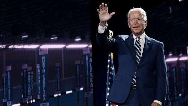 PHOTO: Former vice president and Democratic presidential nominee Joe Biden waves on stage at the end of the third day of the Democratic National Convention at the Chase Center in Wilmington, Del., on Aug. 19, 2020. (Olivier Douliery/AFP via Getty Images)