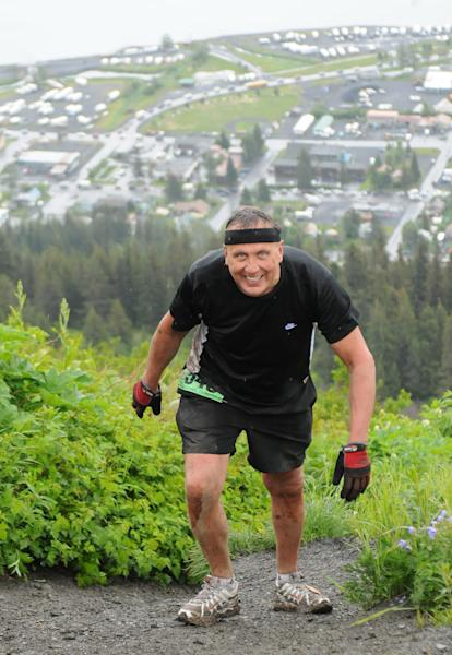 File - In this July 4, 2012 file photo provided by TSS Photography, 65-year-old Michael LeMaitre competes in the Mount Marathon race in Seward, Alaska. LeMaitre disappeared in the race. The rookie's disappearance during a popular extreme race on the mountain has led to new significant new rules in this year's event. Runners in the July Fourth race have to go halfway up Mount Marathon in an hour or they will have to turn around and participants also must sign a statement saying they've completed the entire race course all the way up the 3,022-foot peak. Organizers say the changes were prompted by the disappearance of LeMaitre, who was slower than average in his first time on the mountain. (AP Photo/TSS Photography, Davis Stewart, File)